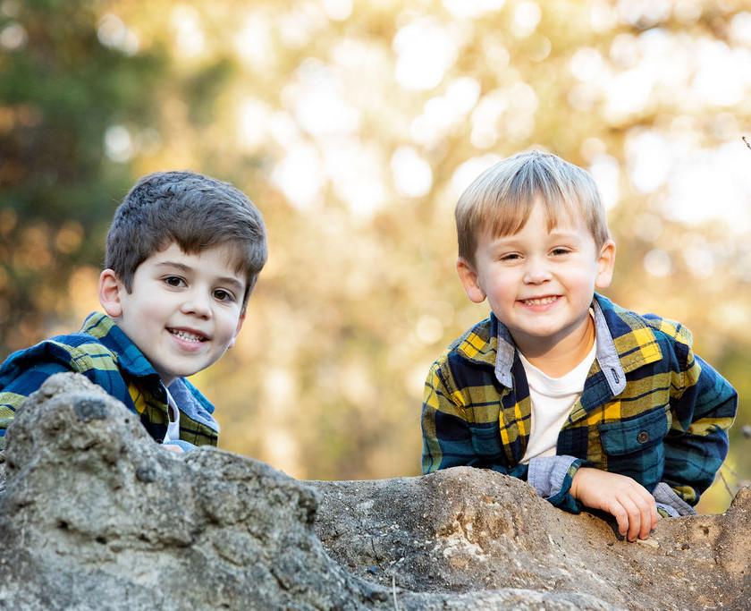 2 smiling boys posing