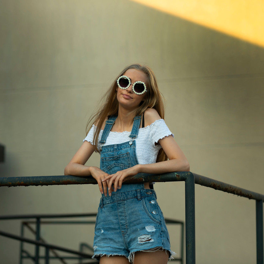 Model in sunglasses on stairs