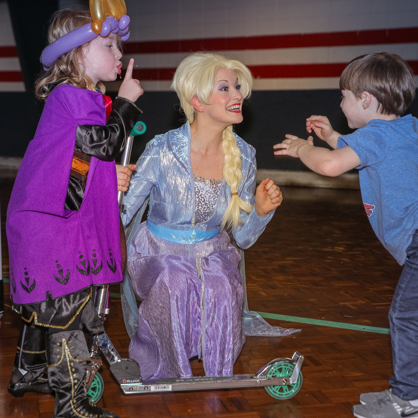 Elsa posing with the birthday boy and birthday girl