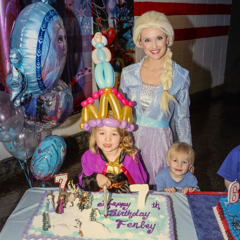 Elsa with the birthday girl and her cake