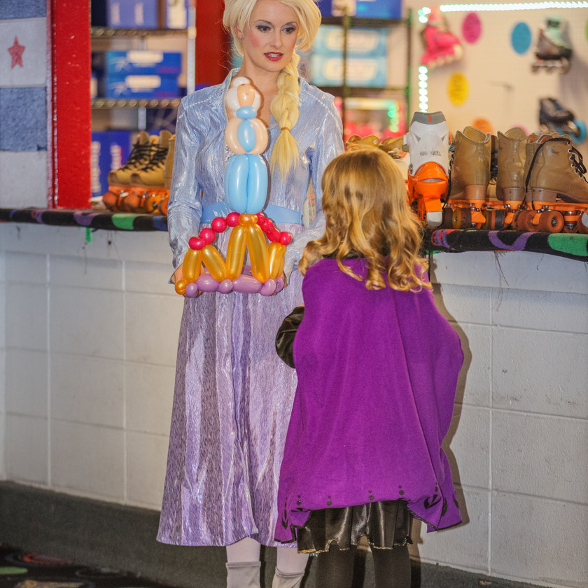 Elsa presents a balloon crown to the birthday girl