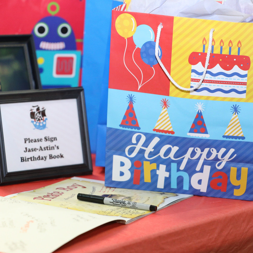 photo of the guest book and decorations at a children's birthday party