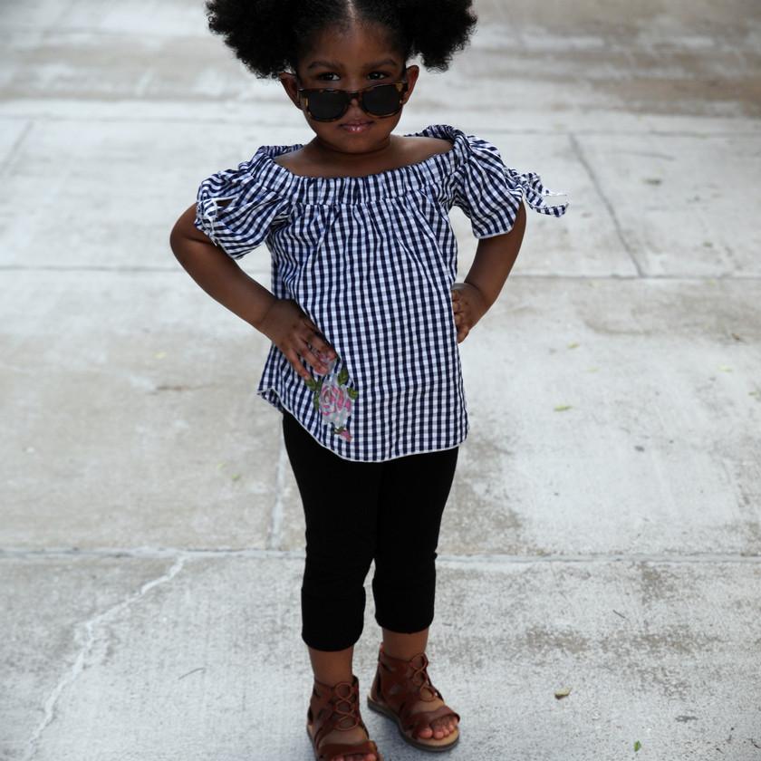Daughter posing in sunglasses