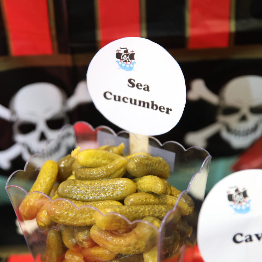 a bowl of small pickles or cornichons at a pirate themed party