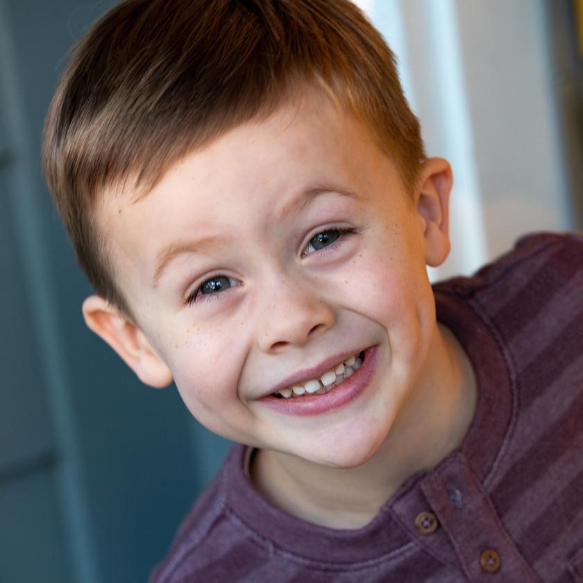 Closeup photo of a young boy, kids photography