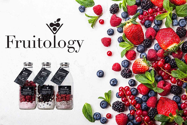 Fruitology banner with logo and gift bottles