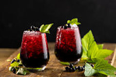 Whisky or brandy and blackcurrant