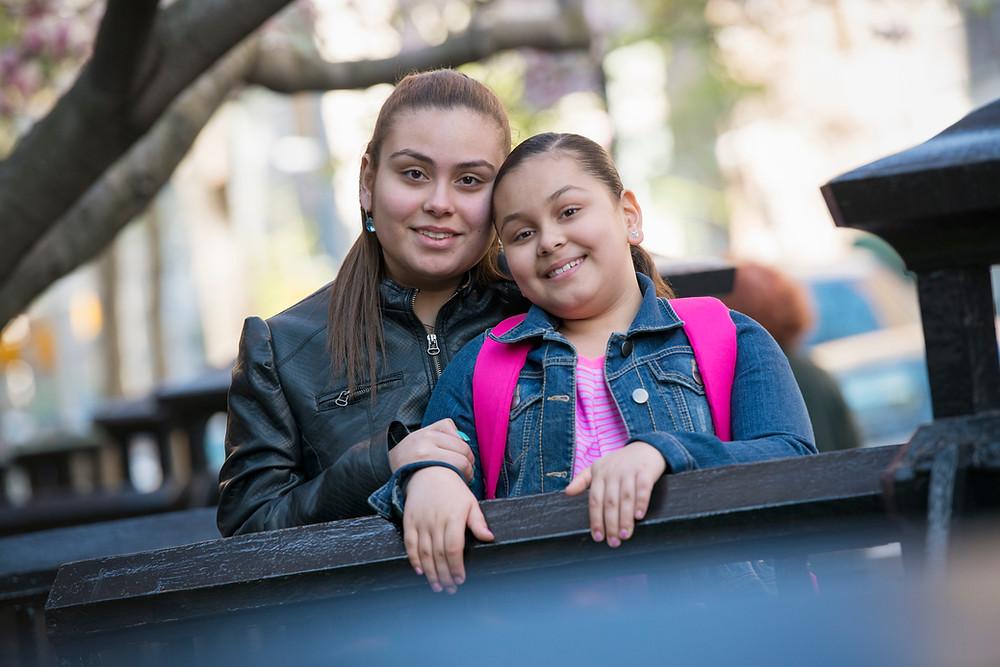 Photo of teen and tween sisters