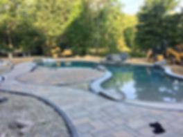 Pool waterfall and patio instalation