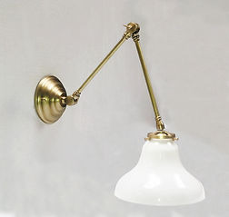 Adustable brass sconce by Omega Lighting & Design in Berkeley