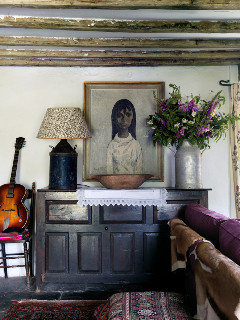 Sitting room with old grain chest and a low wattage lamp in the house