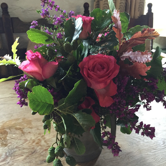 A posy of oak leaves, heather and roses
