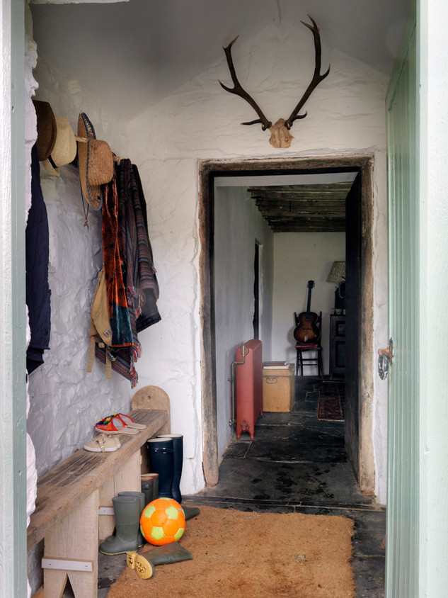 The entrance porch and flagstone floors welcome you in