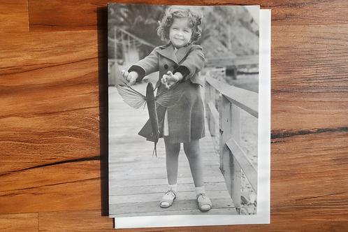 Girl Holding Flying Fish Single Notecard