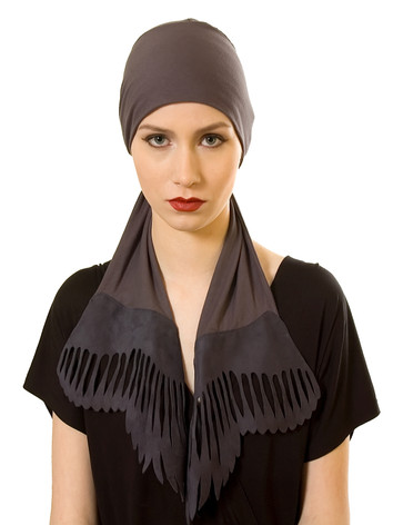 headscarve made of comfortable materials with leather wings. Specially designed for women with hair loss.