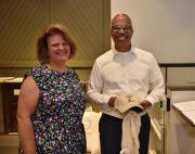Lieutenant Governor showing his historical society gifts with Mary Hushour