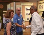Larry Valett, historical society volunteer, greeting Lieutenant Governor Rutherford