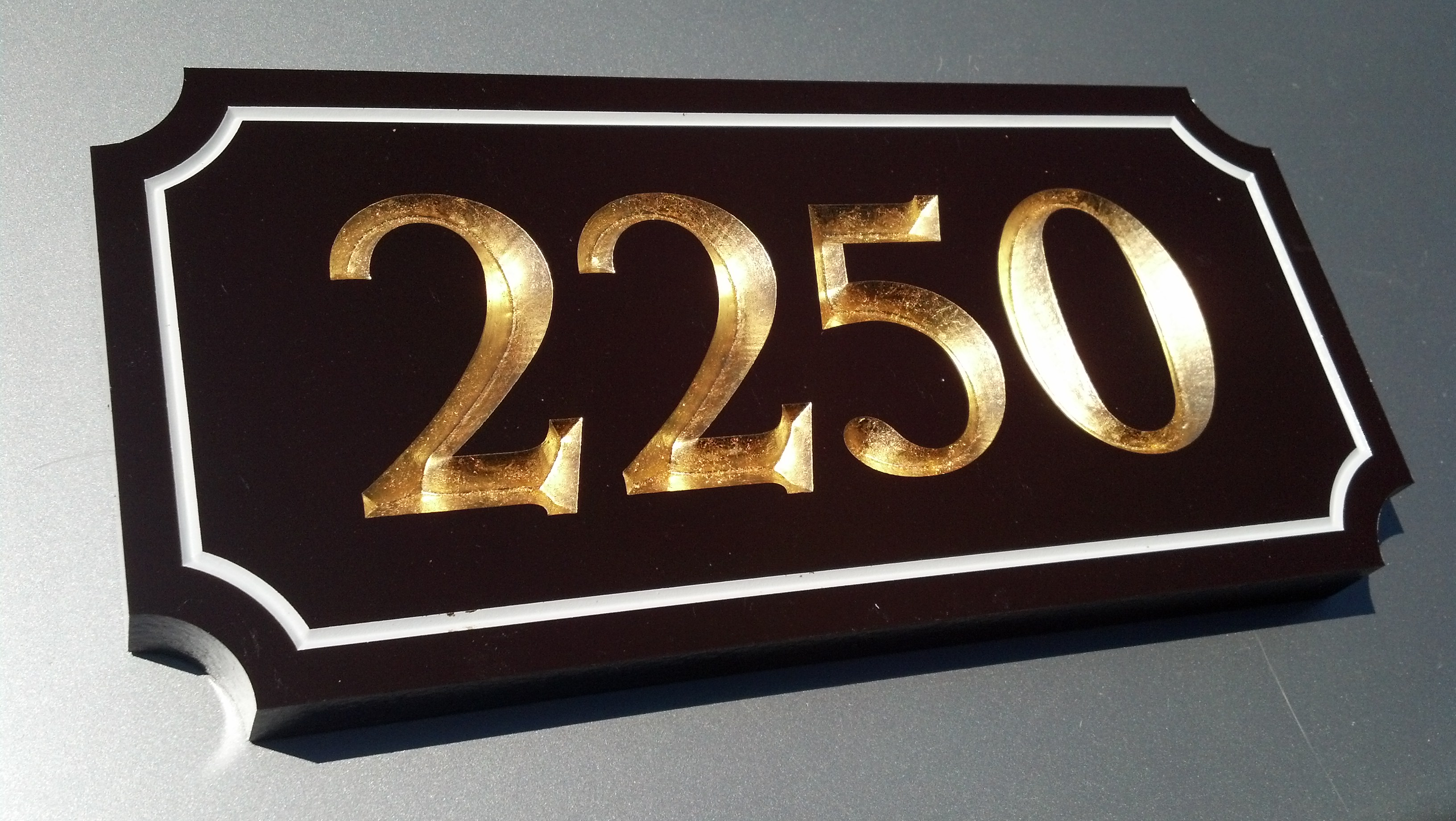 gilded address plaque