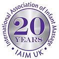 IAIM_20yrs-Logo-2597+BG.jpg