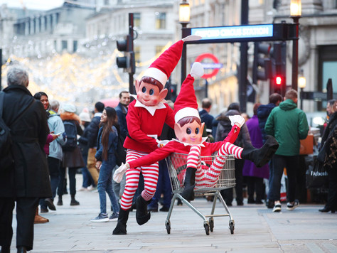 Two giant Elves Behavin' Badly cause chaos in London!