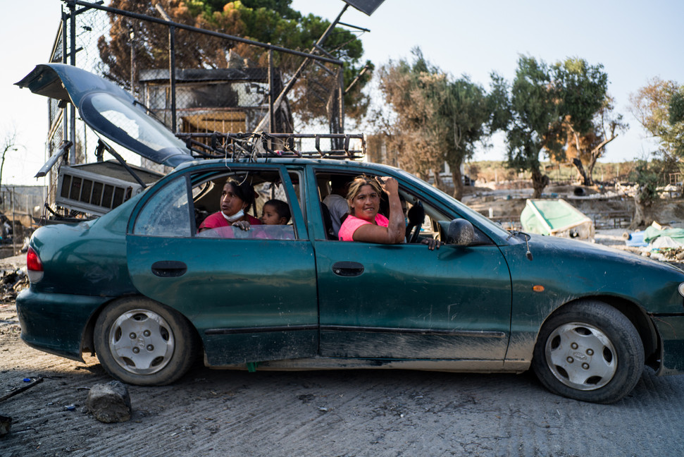 One of the last families that remained in Moria carry their last belongings to head to the new Field.