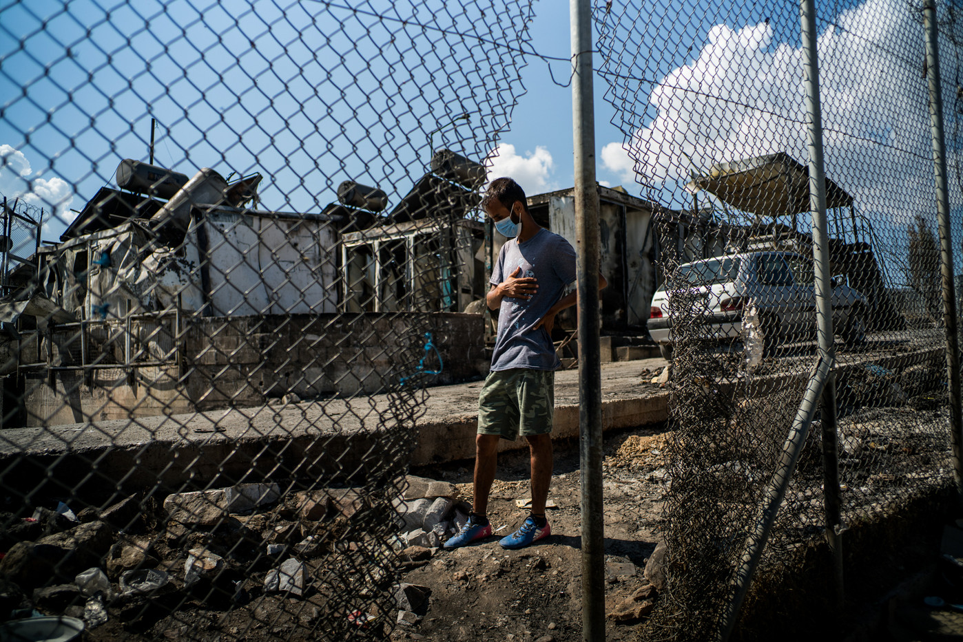 An Afghan migrant looks desolate at the remains of the Moria camp.