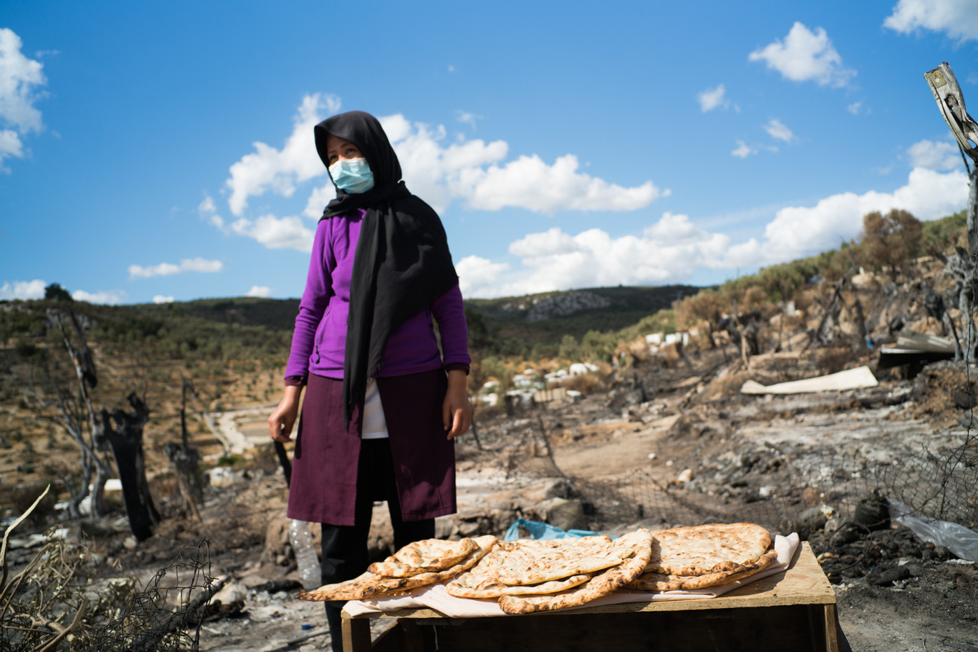 Lalla and her family cook bread every day in the remains of a home oven in Moria´s Camp. The practice of baking bread has been one of the many actions that migrants had to adopt in order to supply their families with more food.