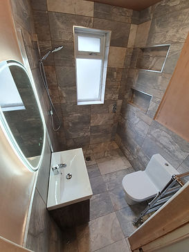 Sink, Shower and Toilet with new Tiles and shelving work to create wet room