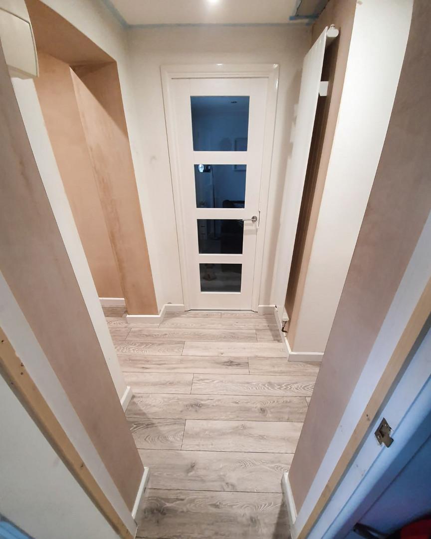 Plastered through porch into hallway area