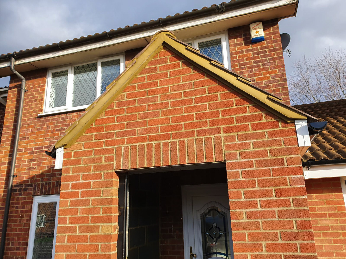 Completed brickwork with roofing tiles and drainiage