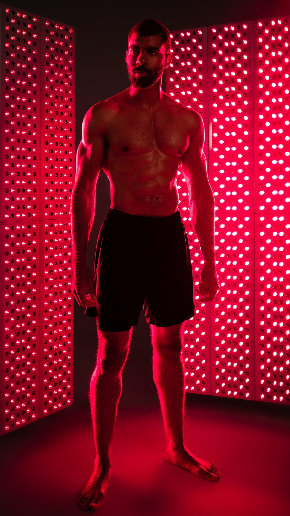 photo of somebody standing between two panels to get red light therapy