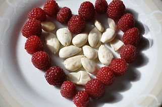 almonds and raspberries in a heart shape
