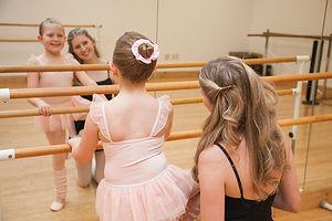 Teacher with child in dance studio