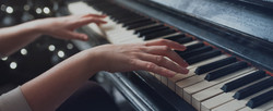Adult playing piano in Howard County