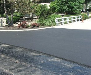What's The Difference Between Asphalt Overlay And Asphalt Sealcoat?