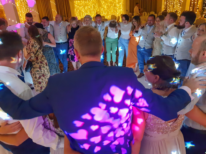Wedding Couple Surrounded by Friends. Dancing to a DJ Disco Package at Doxford Barns