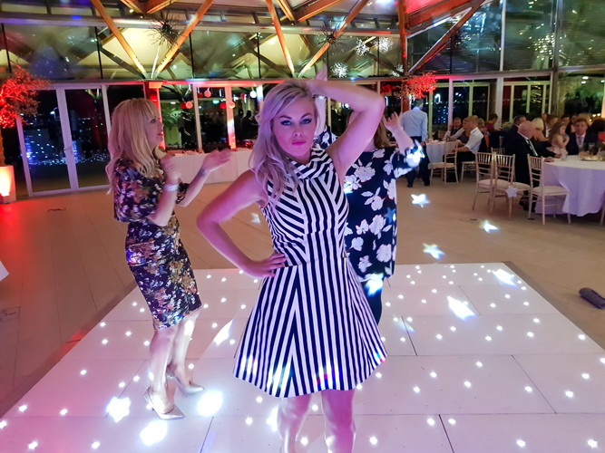 Young Lady Posing on an LED Dance Floor at Alnwick Gardens for a Wedding Disco.