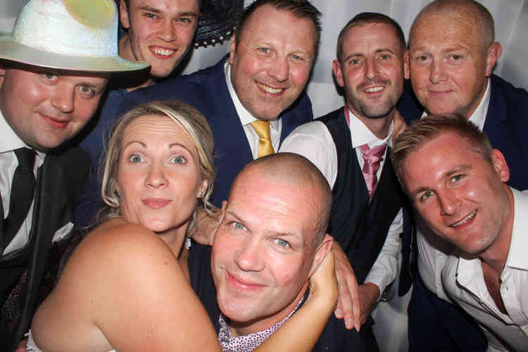 Photo Booth booked for a Wedding Disco Party in Northumberland. Great DJ supplying music and Photographer taking pictures.