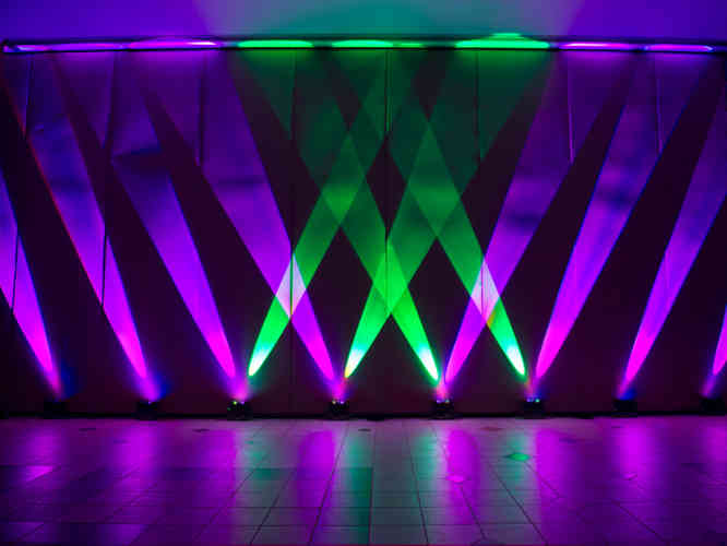 Moodlighting for a corporate event in York. Mood Lighting illuminating the walls while a DJ Playskage