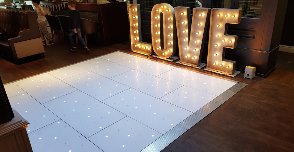 LED Starlit Dancefloor Hire. Book the Perfect Floor in stunning White or Black for a great party. Add a DJ Package or LOVE Letters TODAY