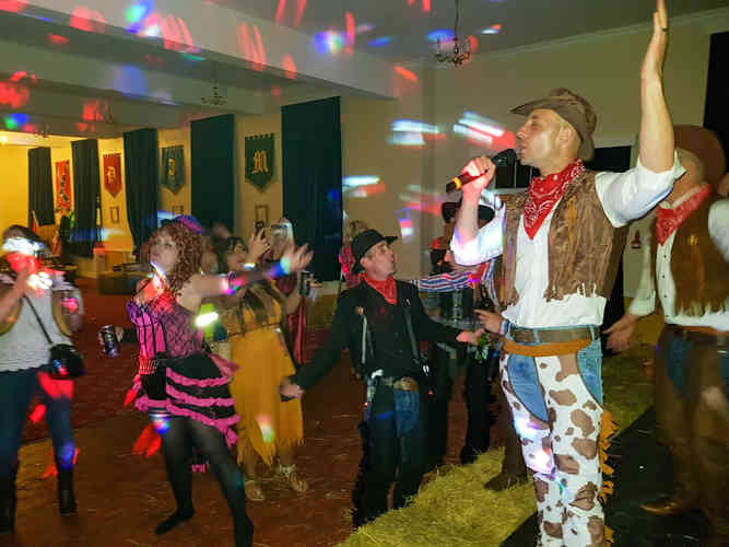 Fancy Dress Cowboy Wild West Themed Karaoke Party. Excellent DJ Hired for a great Disco Night. Friends on the Dancefloor