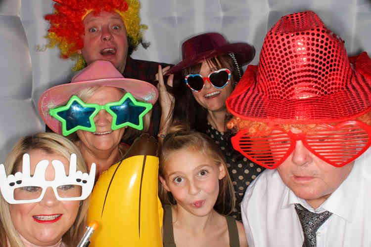 Photo Booth Hired in York for a Birthday Disco Party. Family Wearing Props and being Photographerd having fun
