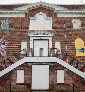 Murals designed by four artistsdecorate a vacant building at 2230 Venable St. in Richmond