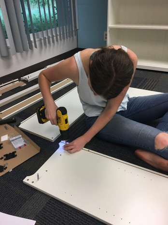Alina building shelves!