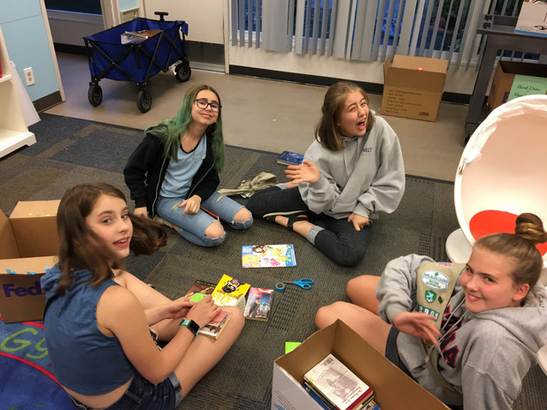 Local Girl Scouts helping sort books