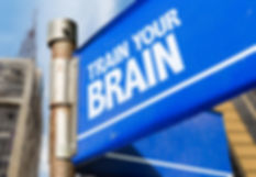 Train Your Brain written on road sign.jp