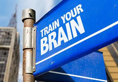 Train Your Brain written on road sign.jp