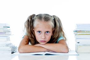 Frustrated little schoolgirl feeling a f