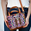 Huipil Leather Bag Crossbody Bag With Geometric Pattern Held in Hands