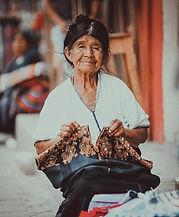 Mayan weaver holds Guatemlan huipil